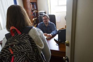 Beacon staff meets with student